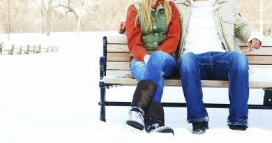 couple on bench in the snow